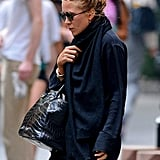 Mary-Kate Olsen wore her hair in a high bun while out with boyfriend Olivier Sarkozy in NYC.