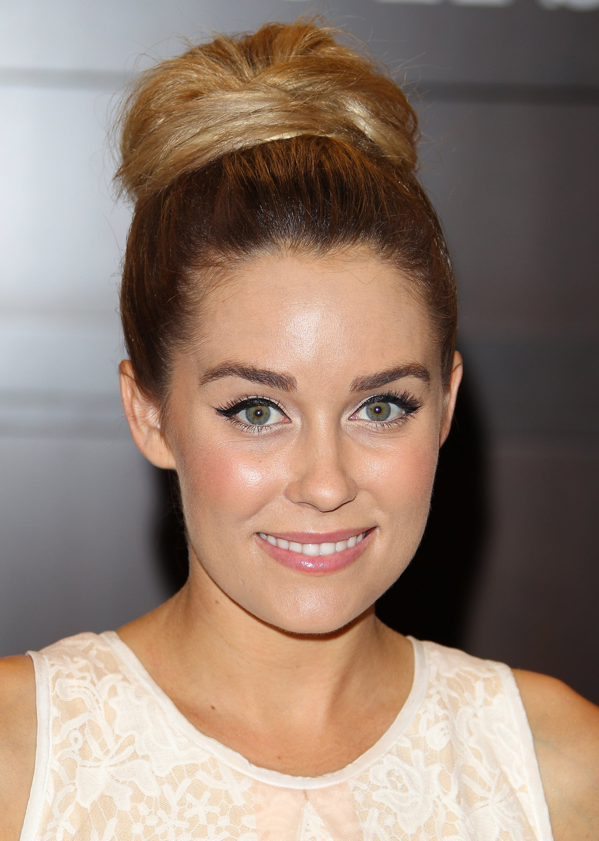 Lauren Conrad's style is more oversize roll than knot, but it's still an ideal look to keep hair off your neck during the hotter months.