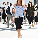 Give your slouchy bermuda shorts a luxe touch with a statement belt and cold-shoulder top.