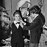 Catherine Deneuve modeled one of Yves Saint Laurent's outfits in 1966.