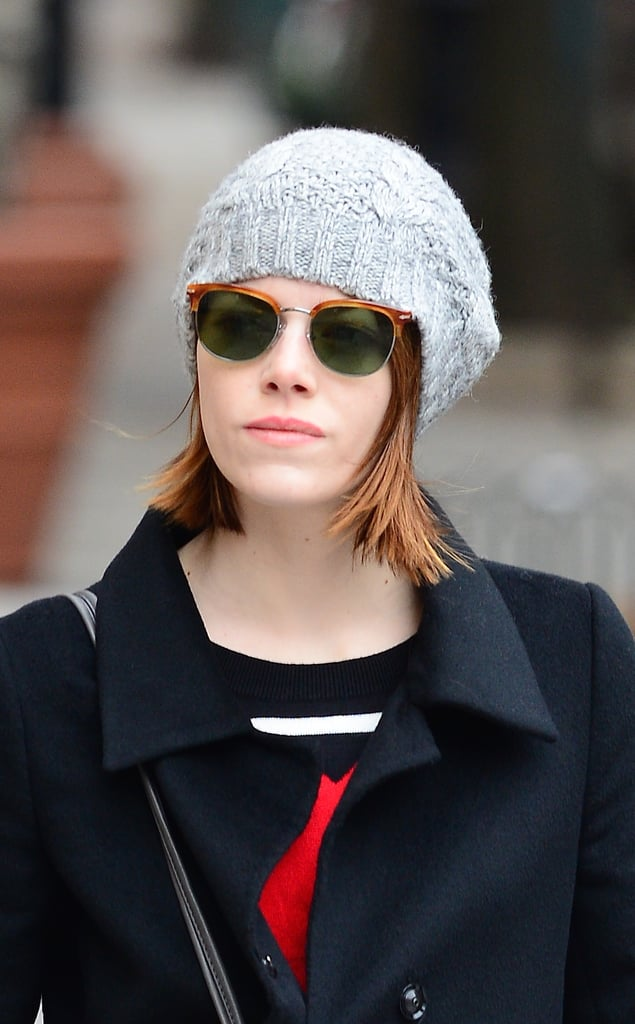 Emma Tucked Her Sunglasses Into Her Beanie