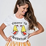 "Walt's Wardrobe White Short Sleeve Unisex Knit ""Cheers to Adventure"" Tee"
