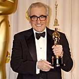 Martin Scorsese showed off his trophy for best director for The Departed in the press room.