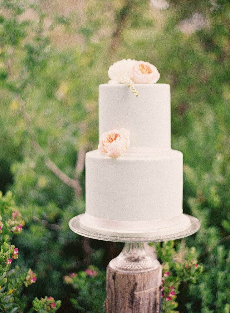 It doesn't take much (just some peonies on a standard design) to get us in full cake crush mode.  Photo by S. Leishman Photography via Style Me Pretty