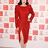 A red sequined Elie Saab Couture was the one for Dita Von Teese at the Sidaction Gala in Paris. To dazzle the night away like Dita did at her event, find a red sequined dress and don't leave home without red shoes, nails, and lips.