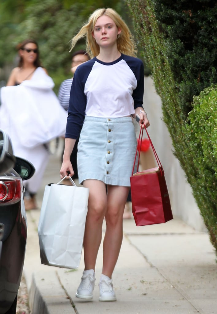 Elle's also got a light-wash version of her denim skirt, which she wore with a baseball t-shirt.