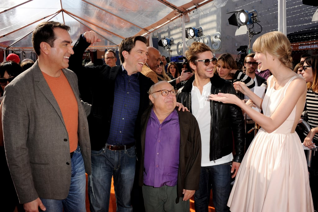 "The orange carpet was rolled out in Hollywood yesterday for the world premiere of Dr. Seuss's The Lorax. Two of the film's stars, Zac Efron and Taylor Swift, in an Honor dress, shared a big hug before making their way down the press line. Ed Helms hit the event solo, but met up with the star of the 3D animated movie, the Lorax himself, for pictures. Danny DeVito brought his family along, and Betty White, who voices the part of Zac's grandmother, was all smiles. We recently sat down with the cast at the LA junket, where Ed hinted about an Office spinoff starring Rainn Wilson and his friendly rivalry with Taylor. Zac touched on his other upcoming projects, The Lucky One and The Paperboy, before giving us his best Matthew McConaughey impression. It was Taylor's first movie junket, but she seemed like a total pro. She described for us the differences between making music vs. acting, and talked with great excitement about her upcoming album. Taylor couldn't reveal an exact release date for the record, but did say it will have a ""different"" sound."