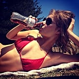 Samara Weaving, tiny red bikini, Diet Coke. We don't think this picture could get any more Summer-esque, and we love it!  Source: Instagram user samweaving