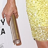 Kate Walsh's slick clutch played off the gold-tinged sequins on her dress.