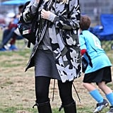 Of course Gwen's mastered the camo trend! For a day as soccer mom, she picked a hooded jacket in a purple-gray print.