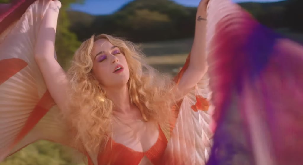 "Katy Perry's latest music video is a trip back to a time associated with tripping, if you catch my drift. For her joyful love song ""Never Really Over,"" the singer released a surreal '70s video that's essentially Hair meets The Love Witch with a sprinkling of Wild Wild Country. As you might've imaged, the beauty looks are just as groovy.  Perry's hair and makeup throughout the video is an explosion of color and curls, with several bright eye shadow looks, big hairstyles, and hair accessories. There's also facial acupuncture and cupping, which fit with the video's whole wellness retreat theme. In a recent talk at YouTube Space in Los Angeles, Perry said in a press release, ""I'm not sure that cupping has ever been in a music video or facial acupuncture and you don't necessarily need injections."" She jokingly added, ""But I mean you could get both."" Ahead, enjoy a breakdown of the many eye-catching beauty moments the ""Never Really Over"" music video has to offer.      Related:                                                                                                           44 Photos Proving How Much Katy Perry's Hair Has Changed in 15 Years"