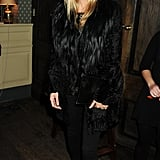 Kate Moss always looks smashing in all black with a touch of fur.
