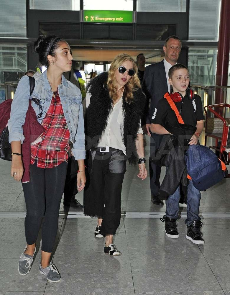 Madonna arrives at Heathrow with Lourdes Leon and Rocco Ritchie.