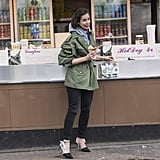 With an oversize jacket, a sporty hoodie, and heels for contrast