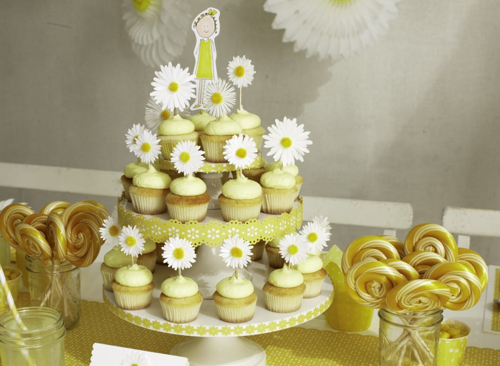 The entire party had a daisy-yellow theme, from daisy cupcake toppers to a centerpiece for the cupcake stand.  Source: Photos by Bryan Gardner. Courtesy of Martha Stewart