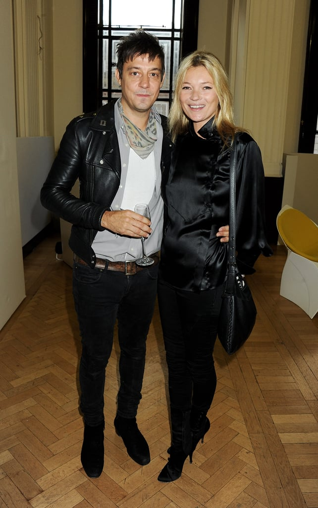 They stuck close together while posing for photos after James Small's London Fashion Week show in September 2011.