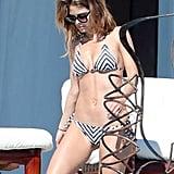 Maria wore a black-and-white two-piece bikini.