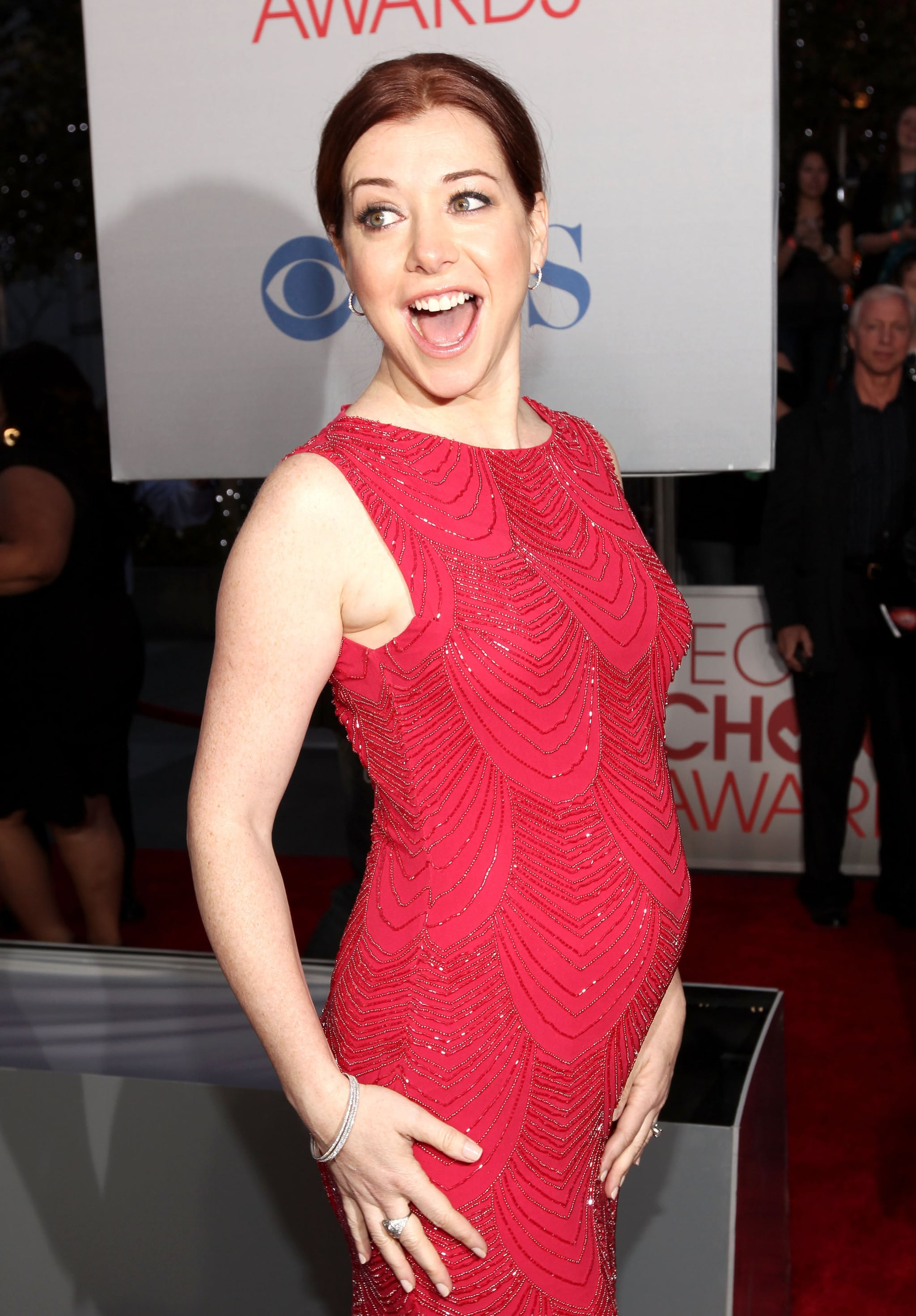 Pregnant Alyson Hannigan in a red dress.