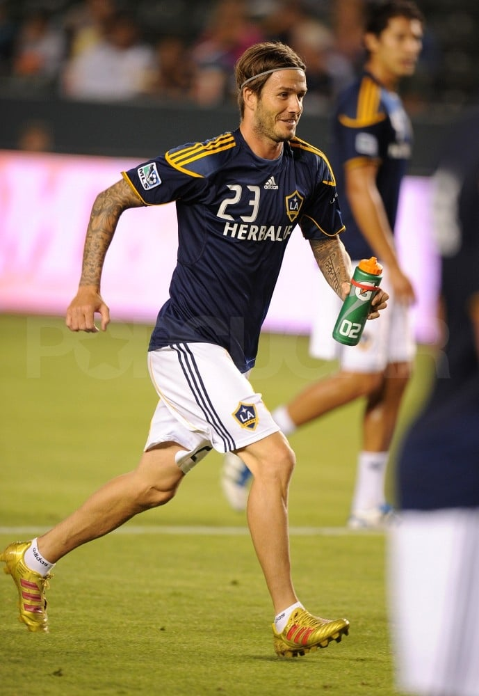David Beckham ran with a water bottle.