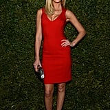 Erin Heatherton wore a simple yet sexy Michael Kors red fitted sheath, strappy nude heels, and a silver clutch.