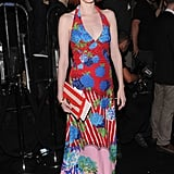 Karen Elson donned a summery halter-style dress, with a beachy striped clutch, to the Marc Jacobs Spring '13 show.