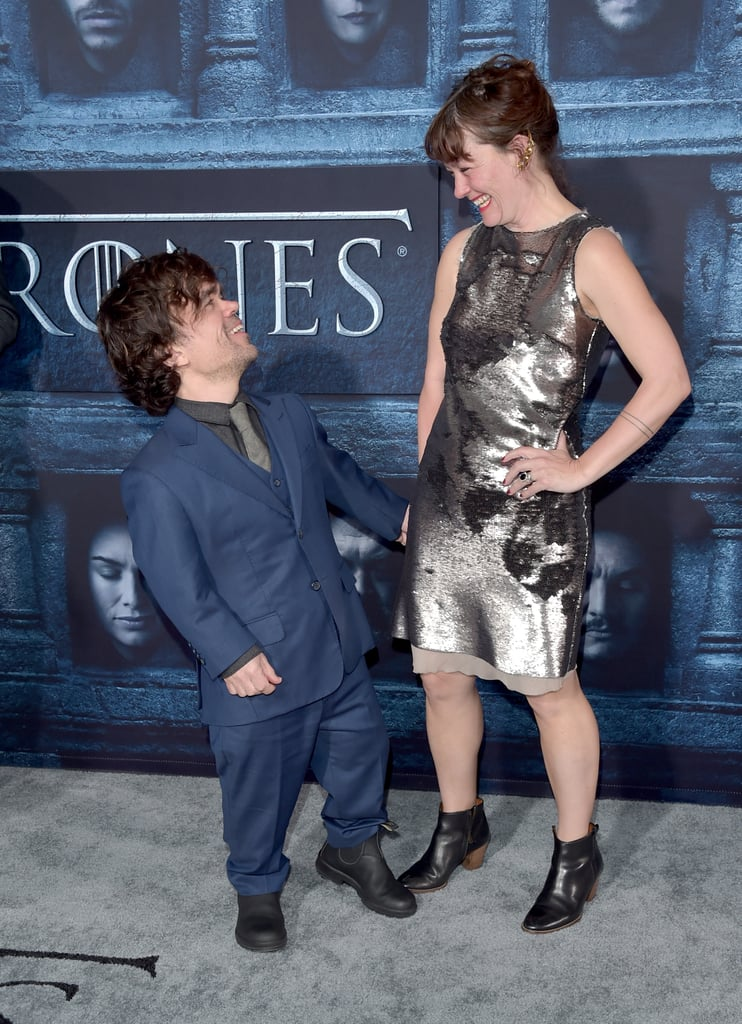 Peter Dinklage is well-known for his role on Game of Thrones, but in real life, he's a loving husband and father. In 2005, the actor married theater director Erica Schmidt, and they welcomed their first child, a daughter whose name has not yet been revealed, in 2011. While the two are usually pretty reserved about their romance (and their family life), they have been known to show sweet PDA from time to time on the red carpet. Whether they're giving each other heart eyes at the Game of Thrones premiere or they're supporting each other at the Emmy Awards, it's clear these two have a lot of love for each other. As they get ready to welcome their second child, see some of their best appearances over the years.