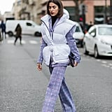 Treat your puffy vest as its own form of outerwear and layer over a pantsuit for that unexpected street style twist.