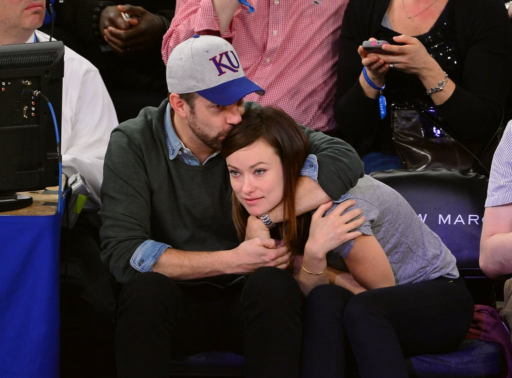 Jason Sudeikis planted a sweet smooch on Olivia Wilde's head as they took in a Knicks game in NYC in March 2013.