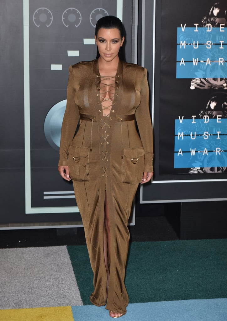 While pregnant with her son, Saint, Kim showed off her pregnancy bump in this olive-green Balmain gown at the MTV VMAs in 2015.