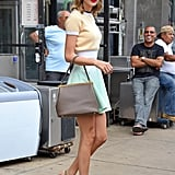 Taylor embraced her inner pinup girl in this retro-inspired look that included a ringer tee, flared skirt, and structured bag.