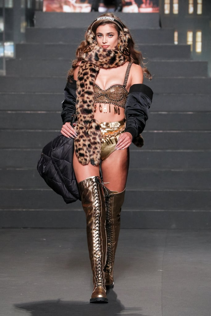 Taylor Hill Wore a Gold Two-Piece With a Leopard-Print Scarf and Earmuffs