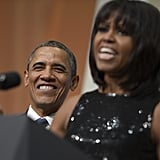 The president gave Michelle Obama a sweet smile at the inaugural reception.