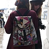A patchwork beanie goes perfectly with a patchwork backpack.