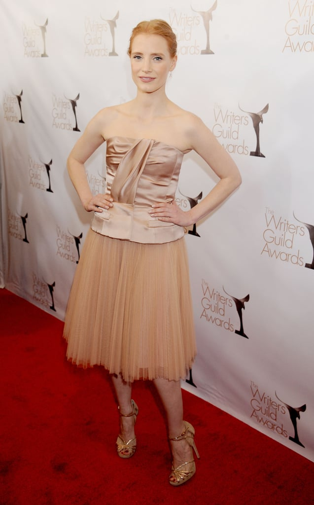 Jessica Chastain went monochromatic in a nude Christian Dior Resort 2013 dress with a tulle skirt and gold Jimmy Choo sandals at the 2013 Writers Guild Awards in LA.