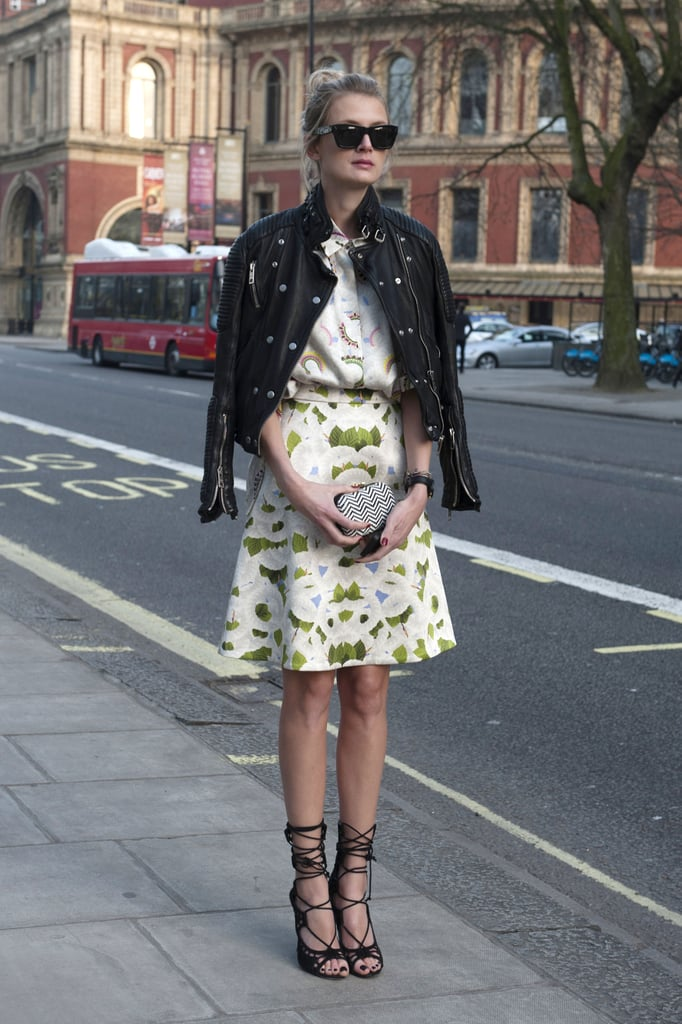High-wattage lace-up heels and a heavy-on-the-hardware leather jacket added a tough-girl counter to pretty prints.