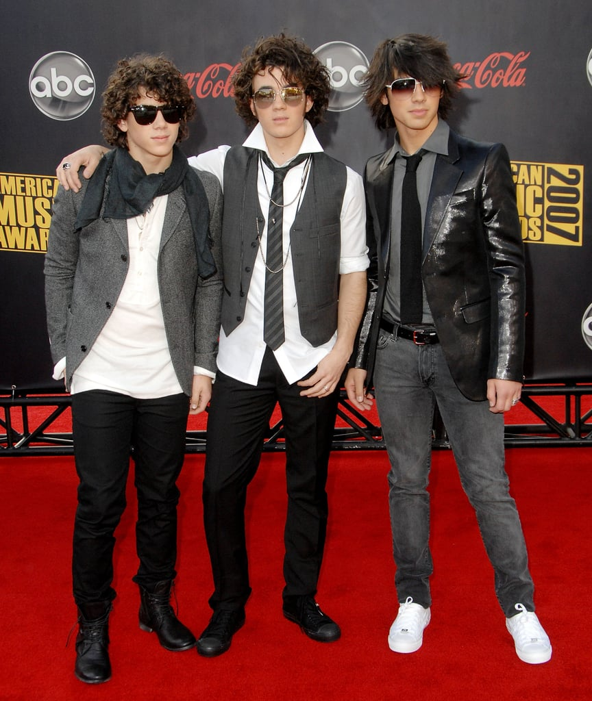 Image result for jonas brothers vests skinny jeans