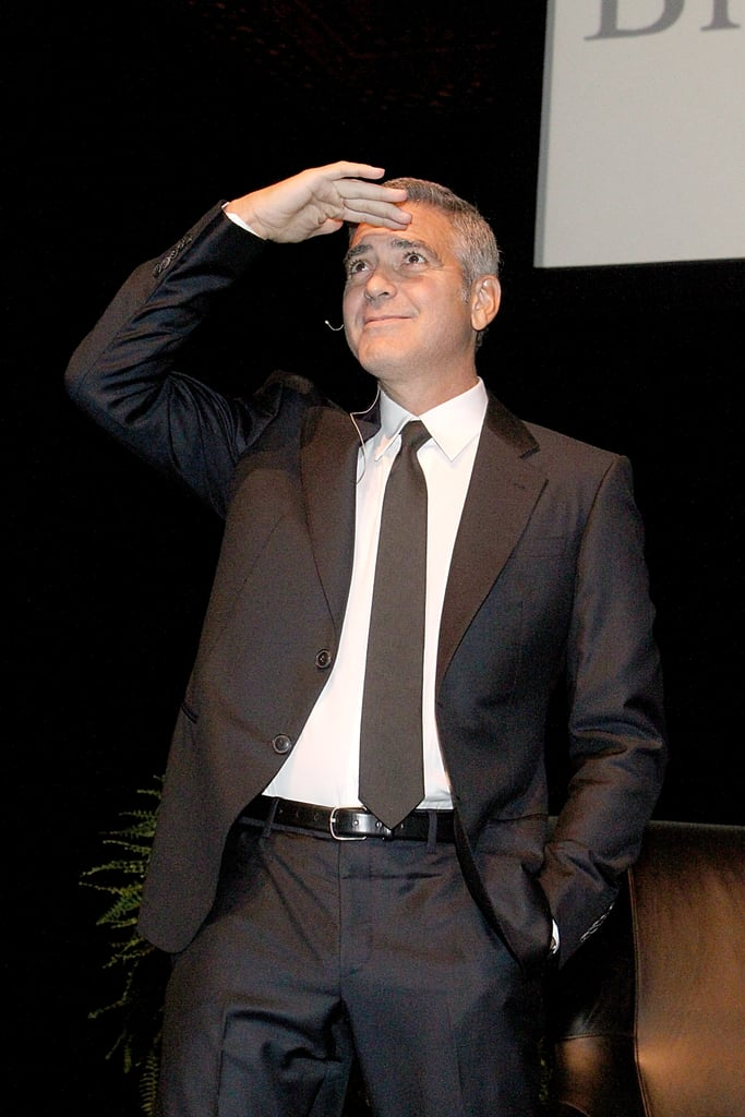 George Clooney posed during an interview with Lynn Wyatt in Houston.