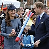Kate Middleton and Prince William laughed while preparing to throw a foam toy during an event in June.