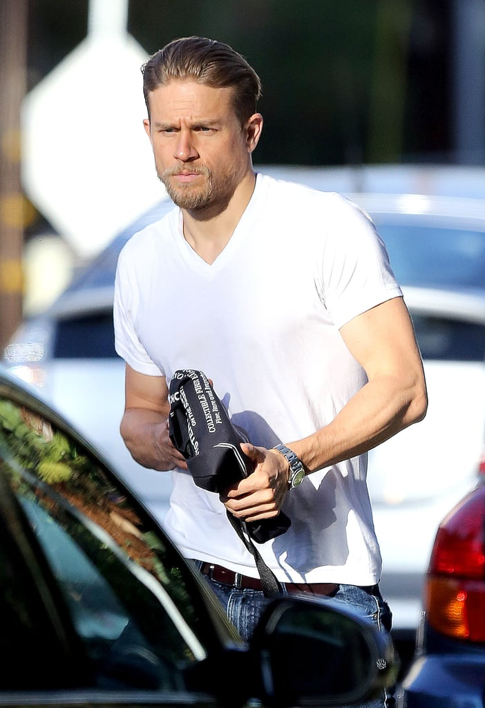 "Charlie Hunnam was spotted running errands in LA on Thursday, one of which included stopping by the gym for a workout. The former Sons of Anarchy star made his way down the street in a white t-shirt and jeans and showed off his good looks (and muscles) while holding on to a black tote bag. Just last weekend, Charlie attended Comic-Con in San Diego to promote his upcoming film, King Arthur: Legend of the Sword, and also opened up about why he won't be joining Idris Elba and John Boyega for Pacific Rim 2, saying, ""By the time they got their schedule fully realized then I wasn't available. But I think they're onto something very exciting."""