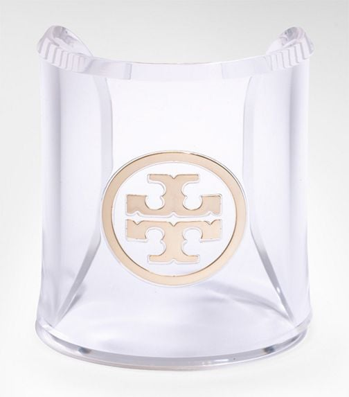 Wear this lucite bangle alone and let it have the spotlight.  Tory Burch Clear Logo Cuff ($45)
