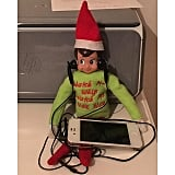 This Elf is making sure his new workout playlist is perfect for his afternoon run.