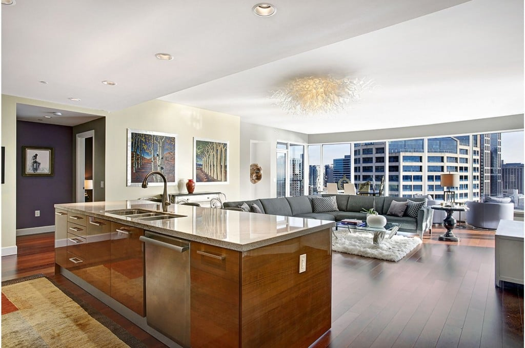 the kitchen is seamlessly laid out next to the living room in the christian grey 39 s penthouse