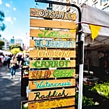 Explore the farmers market together, and share some juicy fruits or tasty snacks to munch on.