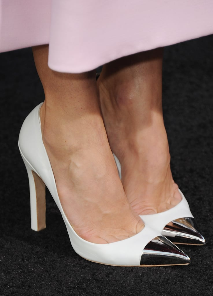Her silver cap-toe pumps from Louis Vuitton added a pop of metallic sheen to the pretty pink Christian Dior Couture dress.