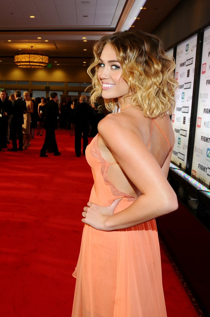 Miley's Jenny Packham gown had a sexy low-cut back and thin crisscrossed straps.