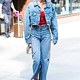 Denim on denim is definitely a stylish way to pull of a monochromatic ensemble. Gigi added pops of red in her outfit with a crop top, lipstick, and Stuart Weitzman Clingy boots. Her Re/Done kick flares were perfect for showing off her shoes and last but not least, Gigi rocked her Stalvey bag.