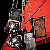 Treat your lifeline — ahem — iPhone or Blackberry this holiday with one of these Dolce & Gabbana phone cases.  Dolce & Gabbana Phone/Media Case with Coin Detachable Purse ($545), Dolce & Gabbana Phone/Media Case with Detachable Wallet ($595)