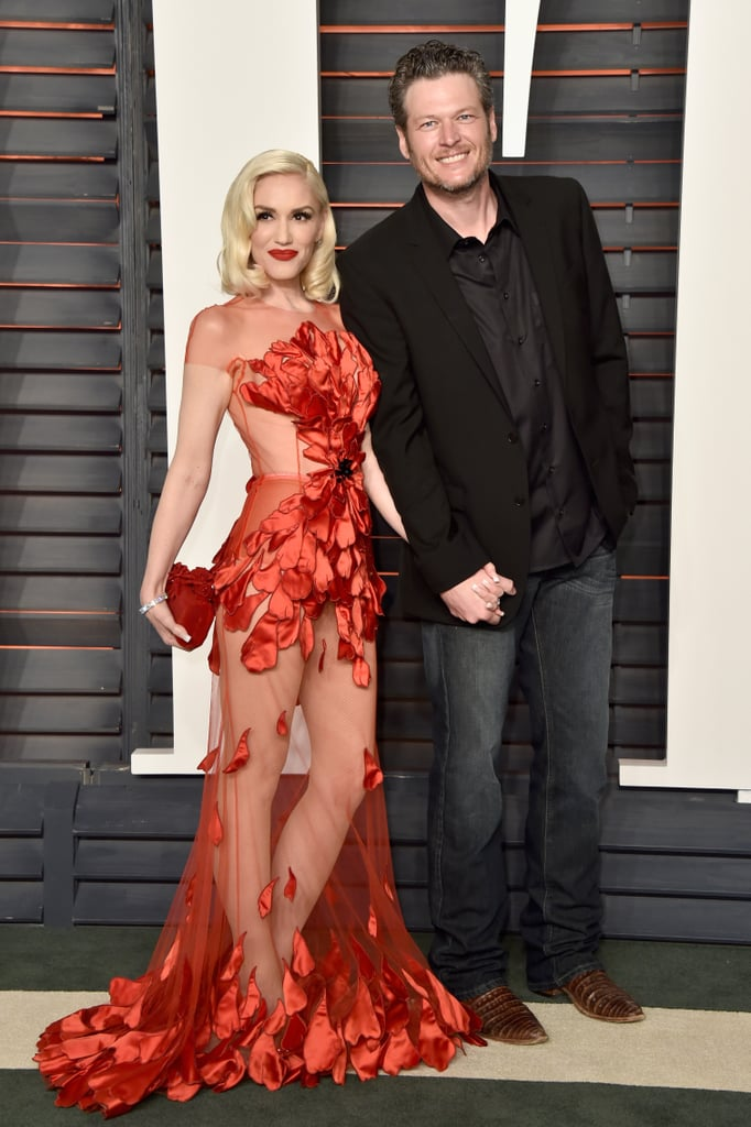 Gwen Stefani and Blake Shelton arrived hand in hand at Vanity Fair's Oscars afterparty on Sunday. The couple smiled big while they posed for pictures, with Gwen sporting a sexy red dress as she linked up with Blake. Their glamorous night out came just a day after the pair attended the wedding of country singer RaeLynn in Tennessee, where they were spotted showing sweet PDA. Keep reading to check out the best pictures of Gwen Stefani and Blake Shelton's night out, then see all the stars who celebrated at the Vanity Fair Oscars bash!