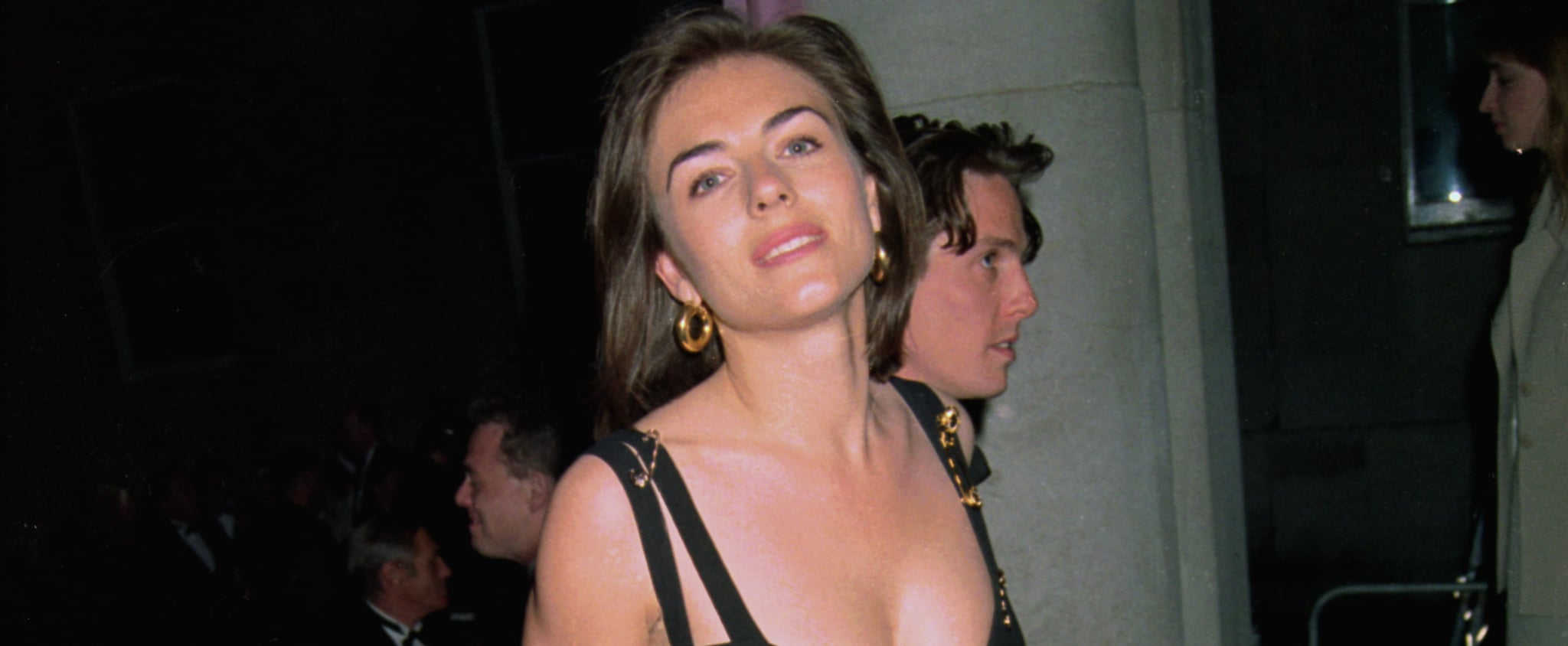 The Story Behind Liz Hurley's Black Versace Safety Pin Dress