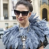 A feathered collar ranks pretty high in the world of statement pieces.